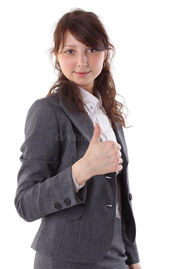 Geschäftsfrau, die Daumen lächelt und aufgibt lizenzfreies stockfoto