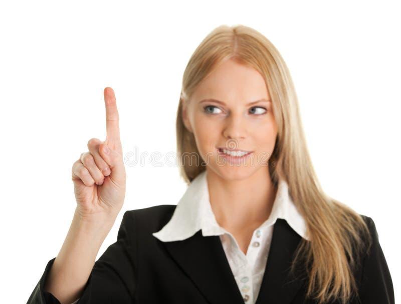 Geschäftsfrau, die den Bildschirm mit ihrem Finger berührt lizenzfreie stockbilder