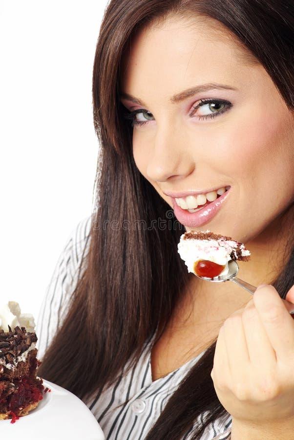 Geschäftsfrau, die den Kuchen isst. lizenzfreie stockfotografie