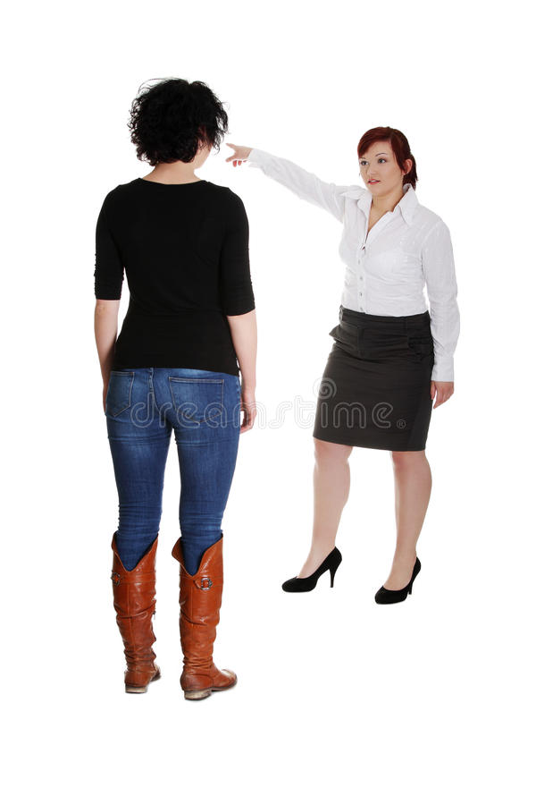 Geschäftsfrau, die der Arbeitskraft Verweis gibt. stockfotos
