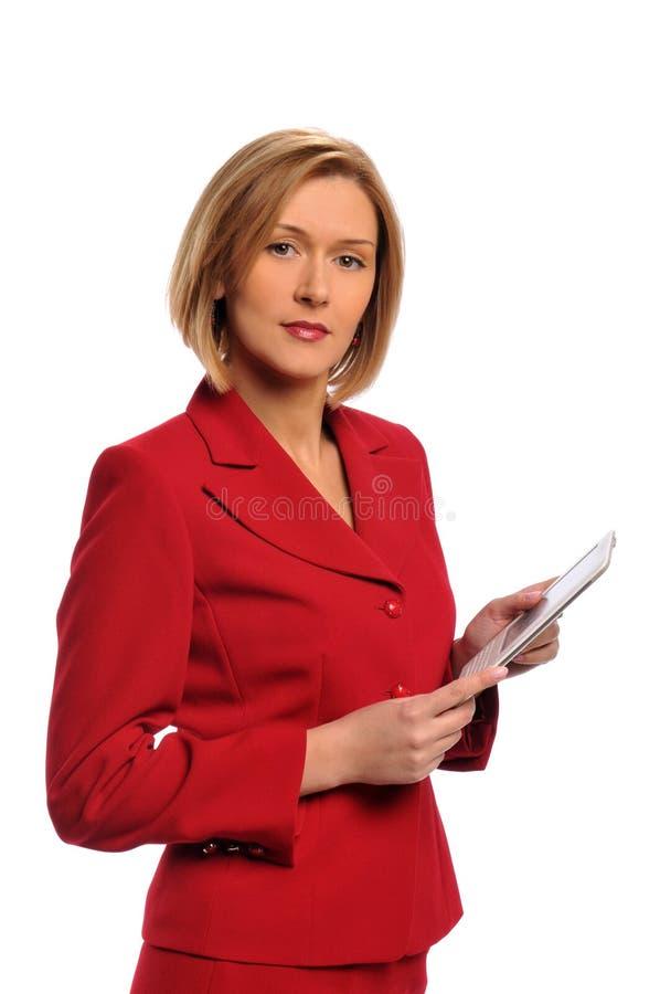 Geschäftsfrau, die ein Ebuch anhält stockfoto