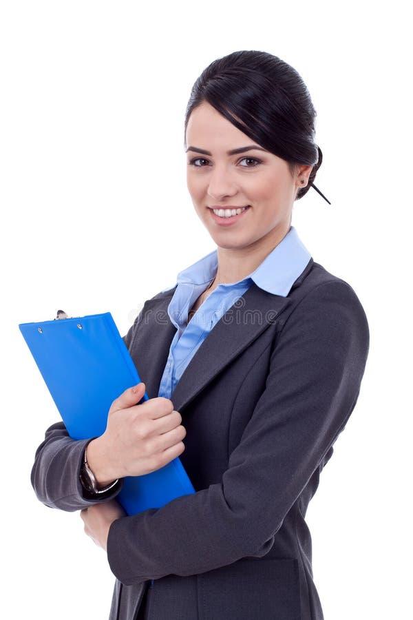 Geschäftsfrau, die ein Klemmbrett anhält stockfotografie