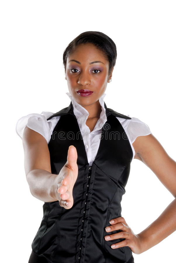 Geschäftsfrau, die einen Händedruck anbietet stockbild