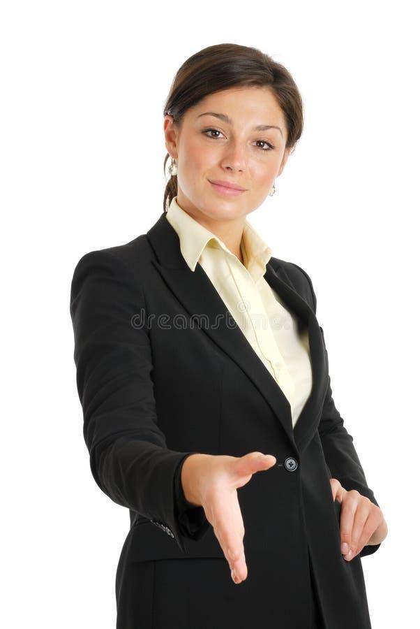 Geschäftsfrau, die einen Händedruck anbietet stockfotografie