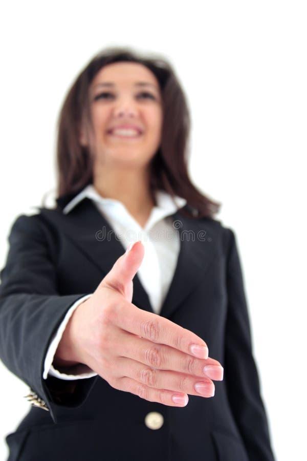 Geschäftsfrau, die einen Händedruck anbietet lizenzfreie stockbilder