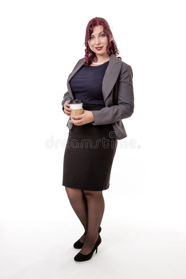 Geschäftsfrau, die einen Kaffee trinkt lizenzfreie stockbilder