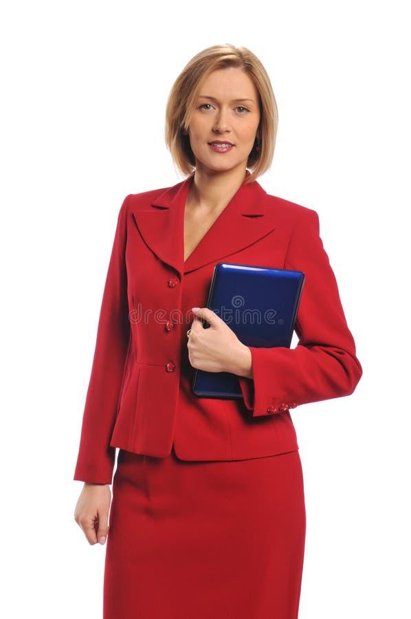 Geschäftsfrau, die einen Laptop anhält lizenzfreie stockbilder
