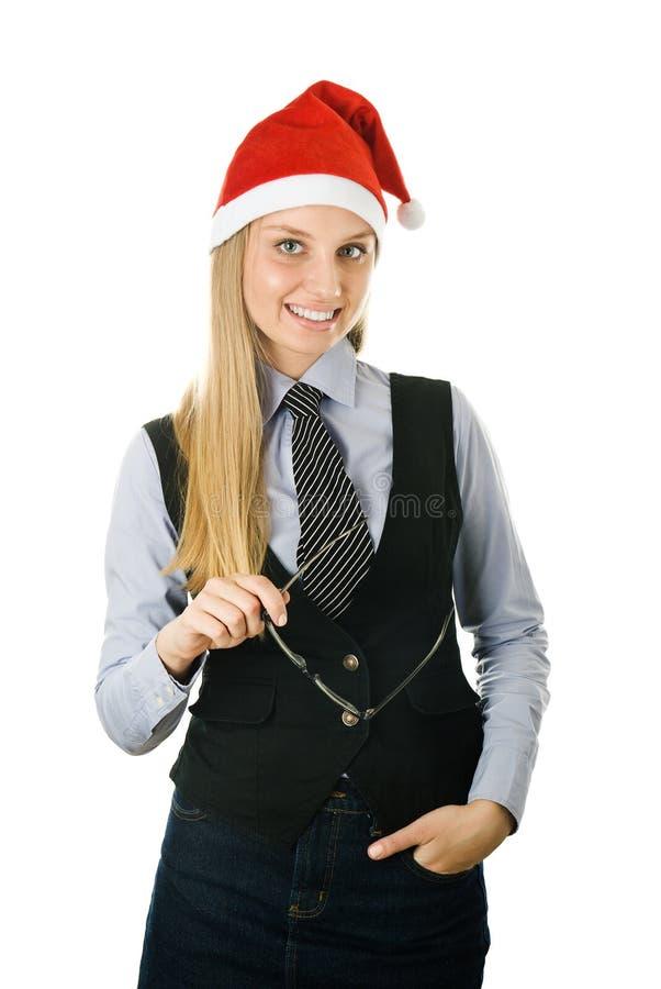 Geschäftsfrau, die einen Sankt-Hut mit Gläsern innen trägt stockfoto