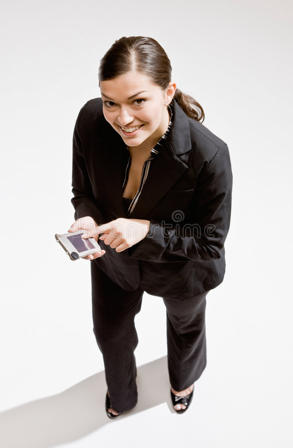 Geschäftsfrau, die elektronischen Organisator verwendet lizenzfreie stockbilder