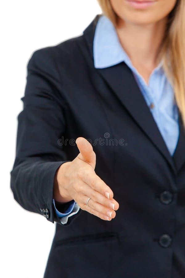 Geschäftsfrau, die für Händedruck anbietet stockbilder