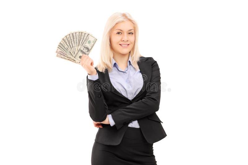 Geschäftsfrau, die Geld hält lizenzfreie stockfotografie