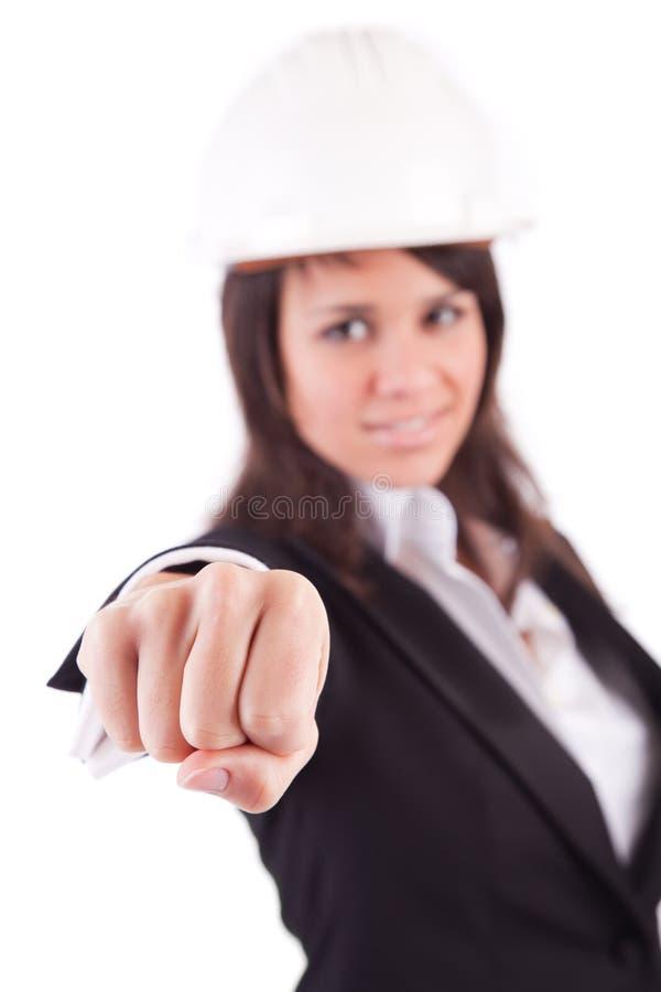 Geschäftsfrau, die geschlossene Hand zeigt stockbild