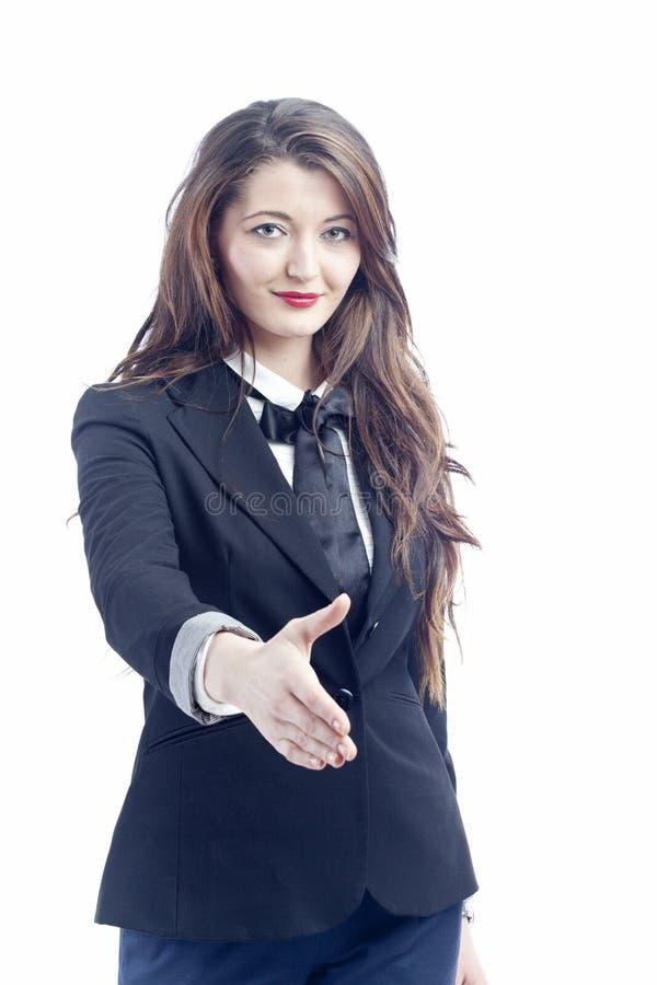 Geschäftsfrau, die Hände rüttelt stockfotografie