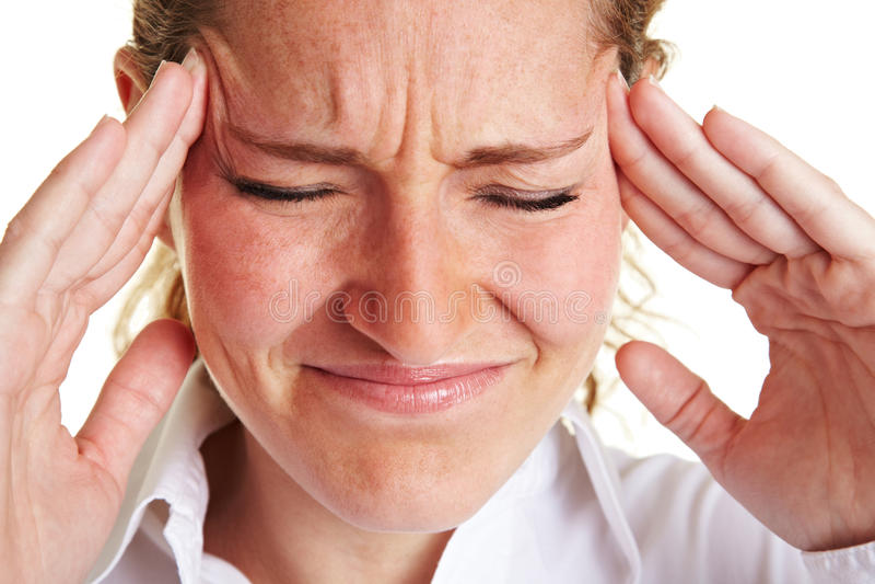 Geschäftsfrau, die ihr Schmerzen massiert lizenzfreies stockbild