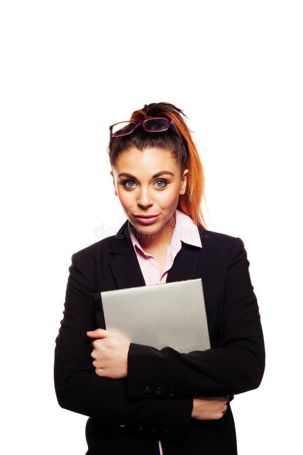 Geschäftsfrau, die ihren Laptop erfasst lizenzfreie stockbilder