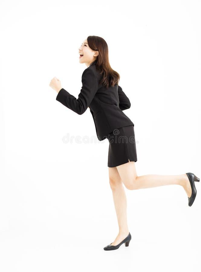 Geschäftsfrau, die oben läuft und schaut stockbild