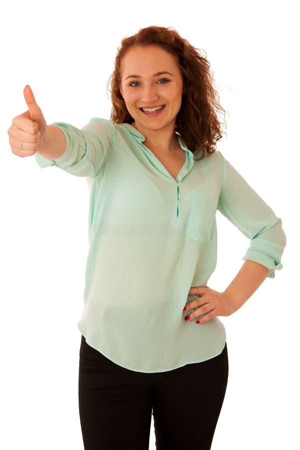 Geschäftsfrau, die sich Daumen als Geste für Erfolg zeigt stockfotos