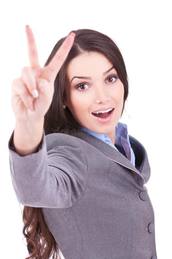 Geschäftsfrau, die Siegzeichen zeigt stockbilder