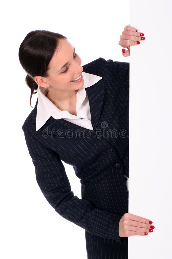 Geschäftsfrau, die unbelegtes Plakat anhält lizenzfreie stockbilder