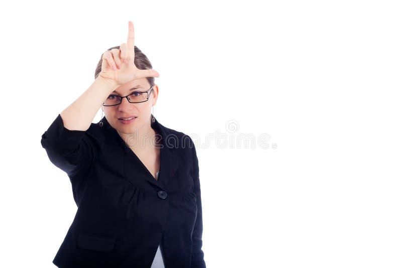 Geschäftsfrau, die Verliererzeichen gestikuliert lizenzfreie stockfotos