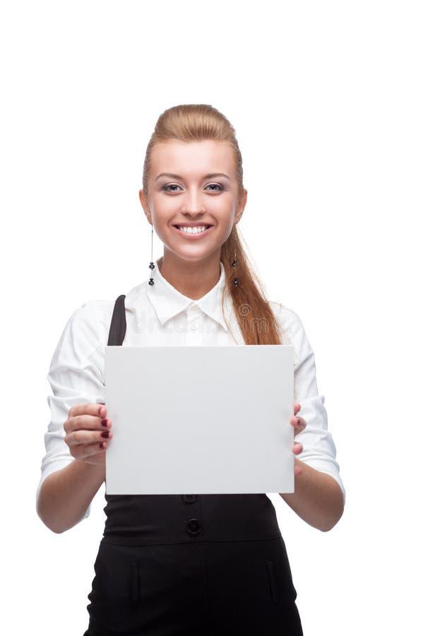 Geschäftsfrau, die Zeichen anhält stockbilder