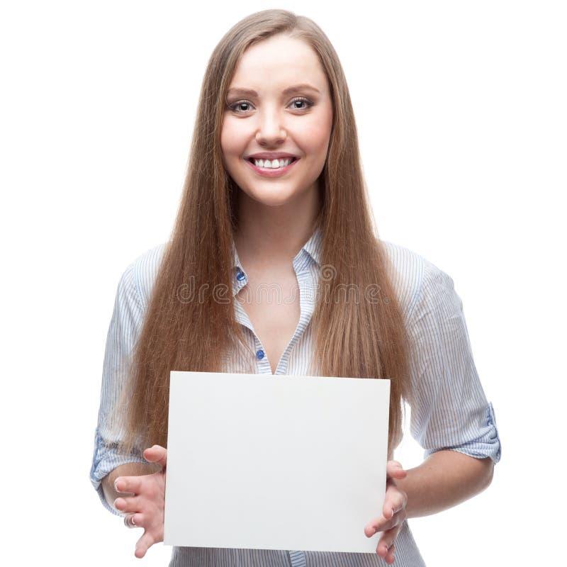 Geschäftsfrau, die Zeichen anhält lizenzfreies stockbild