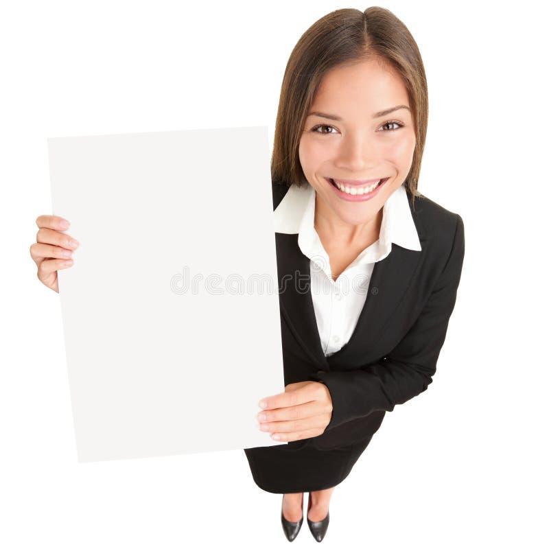 Geschäftsfrau, die Zeichen zeigt lizenzfreies stockbild