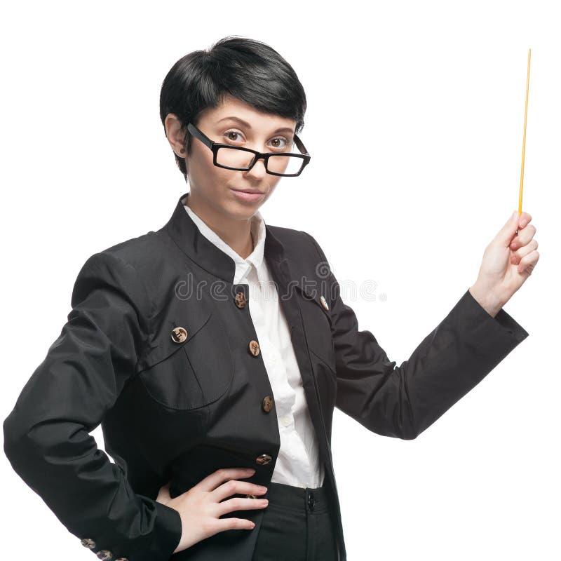 Geschäftsfrau, die Zeiger hält stockbilder