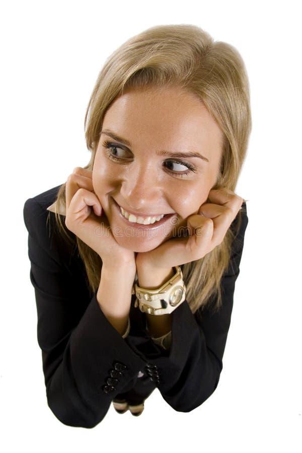 Geschäftsfrau, die zu einer Seite schaut lizenzfreie stockfotos