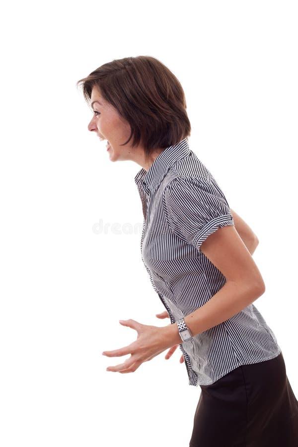 Geschäftsfrau, die zu einer Seite schreit stockbild