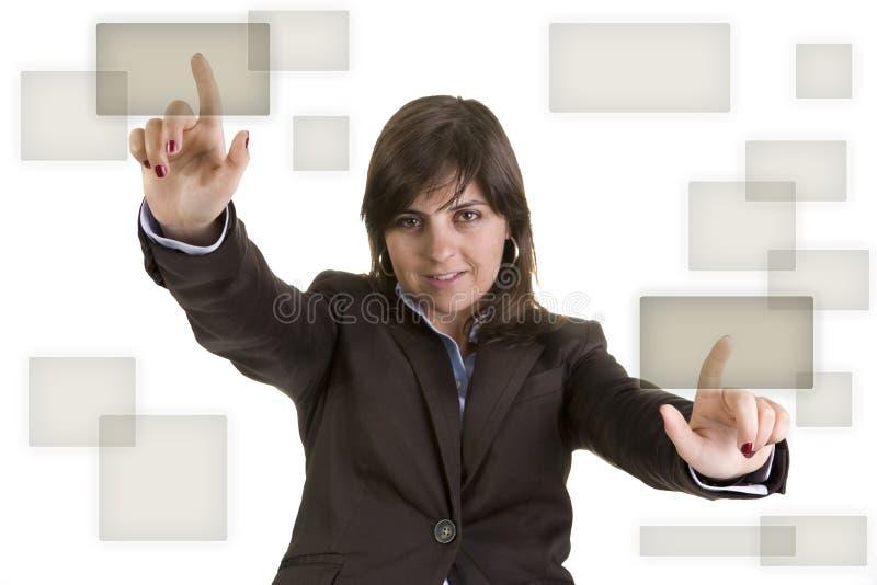 Geschäftsfrau, die zwei Knöpfe betätigt lizenzfreies stockfoto