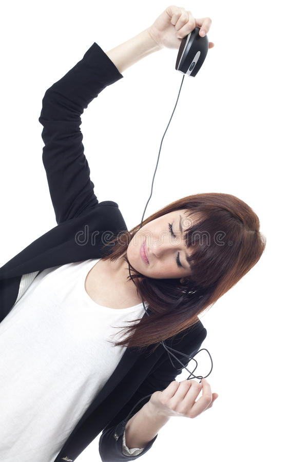 Geschäftsfrau gehangen durch Computermaus stockbild