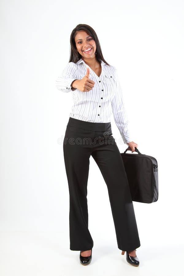 Geschäftsfrau greift oben für Erfolg und Spaß ab stockfoto
