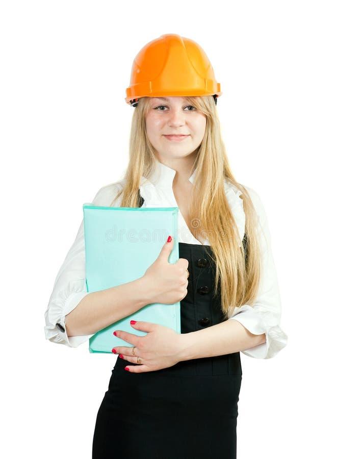 Geschäftsfrau im harten Hut mit Dokumenten lizenzfreie stockfotografie