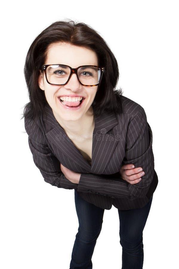Geschäftsfrau, die Zunge zeigt lizenzfreie stockfotografie