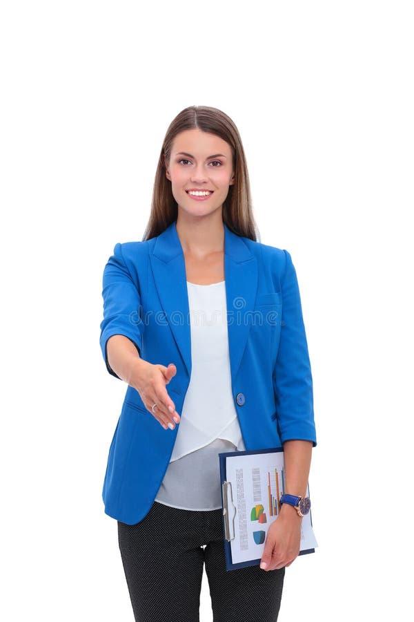 Geschäftsfrau mit dem Arm verlängerte für einen Händedruck lizenzfreies stockfoto