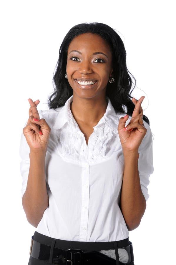 Geschäftsfrau mit den Fingern kreuzte lizenzfreies stockbild