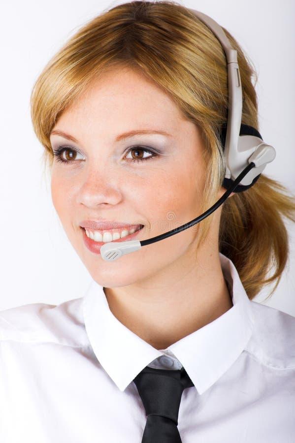 Geschäftsfrau mit einem Kopfhörer lizenzfreie stockfotografie