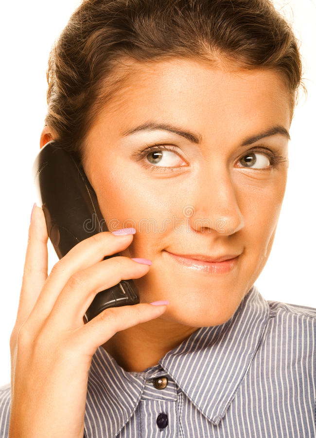 Geschäftsfrau mit einem Telefon stockfotografie