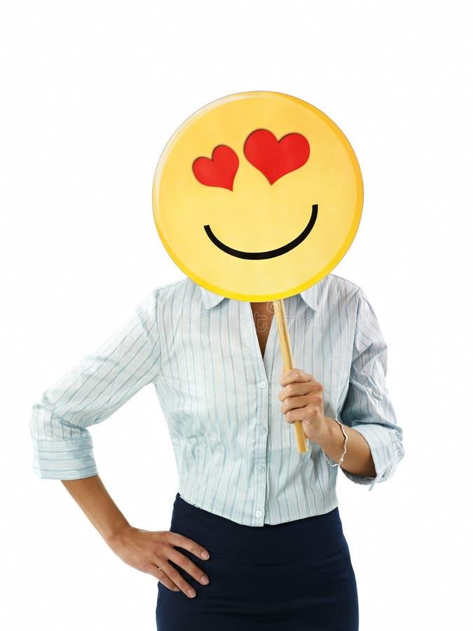 Geschäftsfrau mit Emoticon stockbild