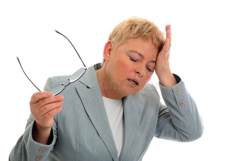 Geschäftsfrau mit Kopfschmerzen stockbilder
