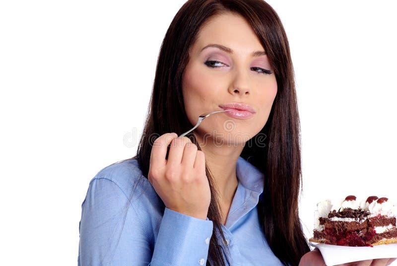Geschäftsfrau mit Kuchen lizenzfreie stockbilder