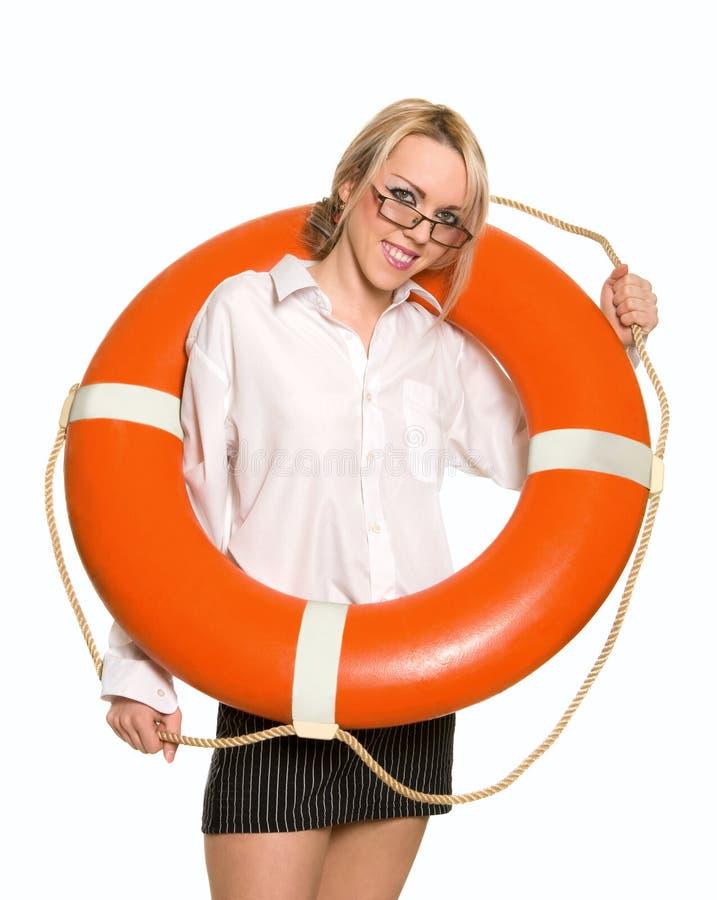 Geschäftsfrau mit roter Lebenboje lizenzfreie stockbilder