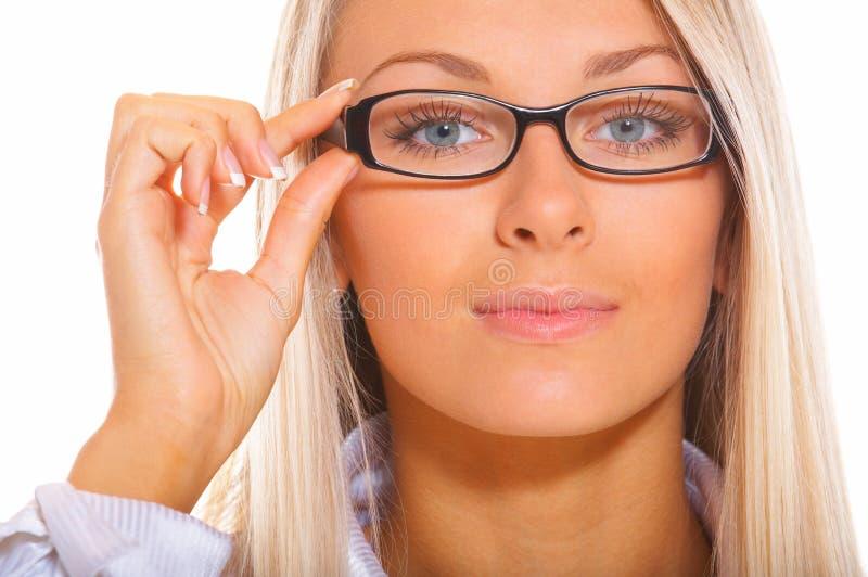 Geschäftsfrau mit Schauspielen lizenzfreie stockfotografie