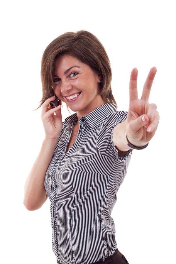 Geschäftsfrau mit Telefon und Sieggeste lizenzfreies stockbild