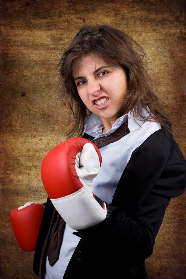 Geschäftsfrau mit Verpackenhandschuhen lizenzfreie stockfotografie