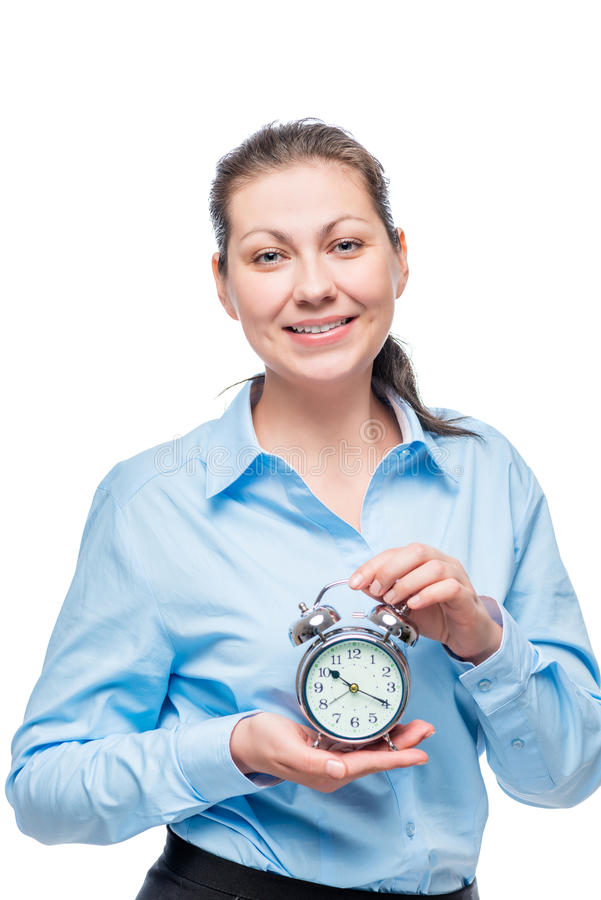 Geschäftsfrau mit Wecker auf weißem Hintergrund stockfotos