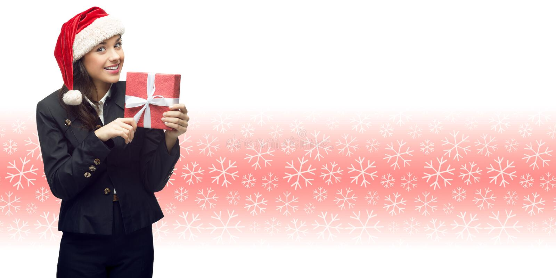 Geschäftsfrau in Sankt-Hut, der Geschenk hält stockfotografie