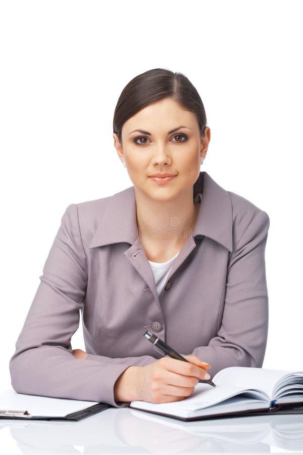 Geschäftsfrau-Schreiben in ihrem Tagebuch. lizenzfreie stockfotos