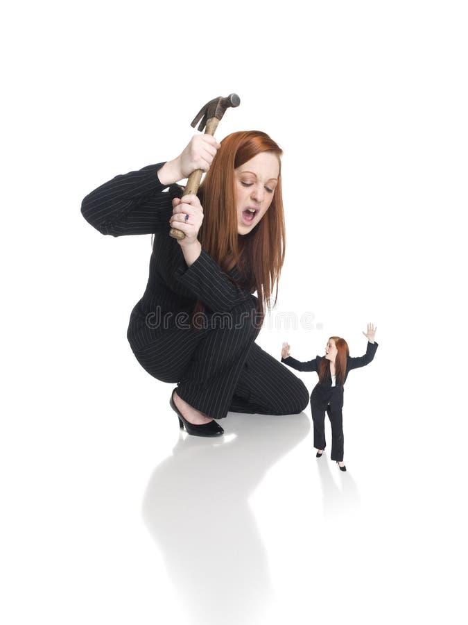 Geschäftsfrau - Selbstniederlage lizenzfreie stockbilder
